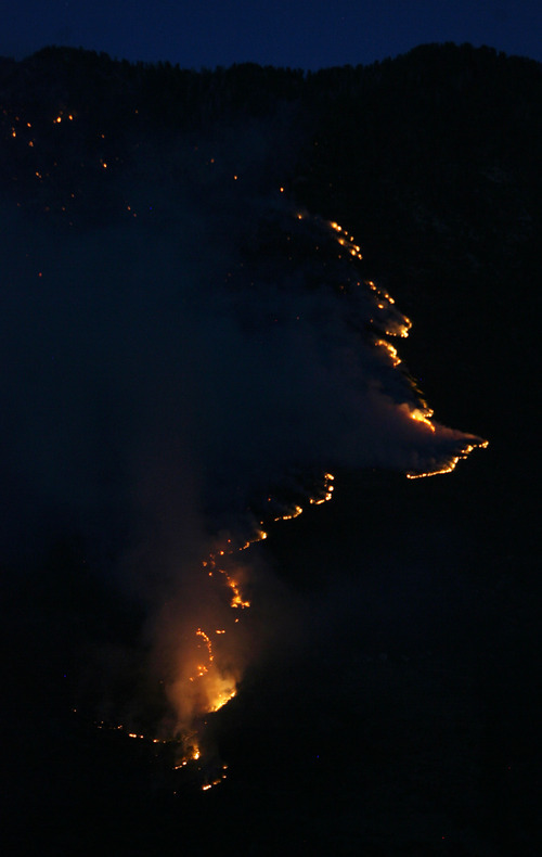 Steve Griffin | The Salt Lake Tribune The Quail fire creeps along the mountains above Alpine, Utah Tuesday July 3, 2012.