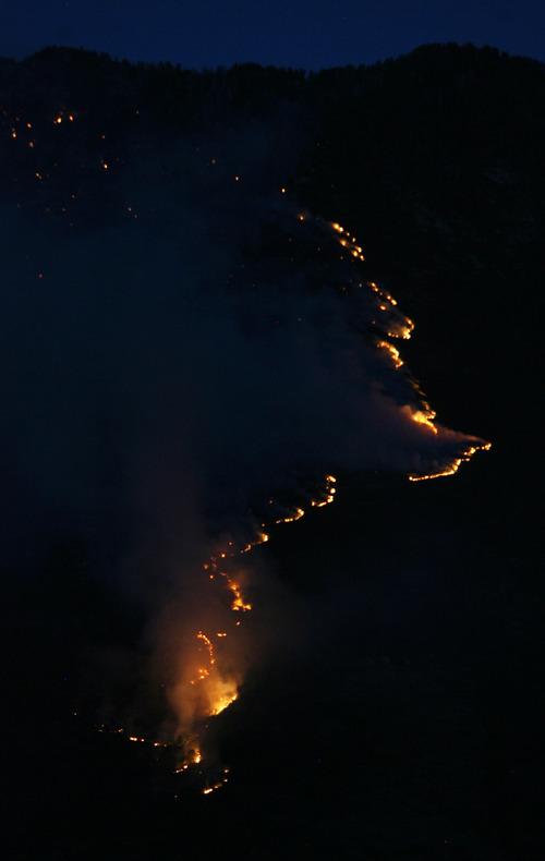 Steve Griffin | The Salt Lake Tribune The Quail fire creeps along the mountains above Alpine, Utah Tuesday July 3, 2012.