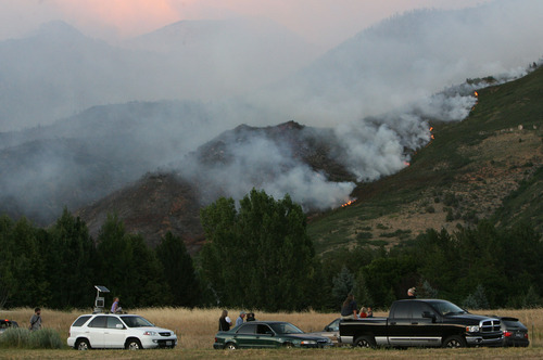 Steve Griffin | The Salt Lake Tribune   People park along roads in Alpine, Utah to get a closer look at a fire burning in the foothills Tuesday July 3, 2012.