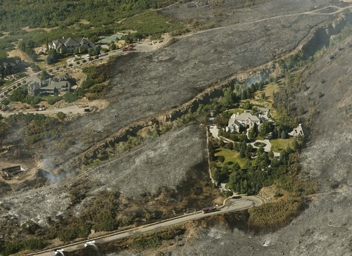 Leah Hogsten  |  The Salt Lake Tribune A home appears to be an emerald island amid the scorched land surrounding it. A wildfire that started about 2 p.m. Tuesday in Lambert Park in Alpine has burned at least one structure -- a barn -- and 80 homes have been evacuated, according to the Lone Peak Police Department. Utah County Sheriff's Sgt. Spencer Cannon said the fire was human-caused, somehow sparked by a man working on a trackhoe near the Alpine rodeo grounds. Tuesday, July 3, 2012 in Alpine