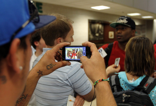 Lennie Mahler  |  The Salt Lake Tribune A passerby videotapes Mo Williams as he arrives at the Salt Lake City International Airport on Monday, July, 2, 2012.