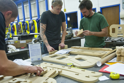 Chris Detrick  |  The Salt Lake Tribune Instructor Todd Erickson helps Mark Polichette, right, and Drew Shetrone build a frame jig during the bike frame building class offered by Granite Peaks Lifelong Learning at Taylorsville High School Tuesday June 26, 2012.