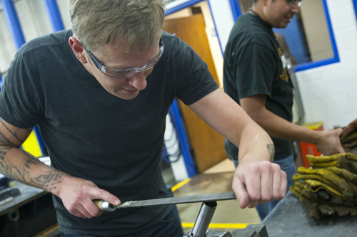 Chris Detrick  |  The Salt Lake Tribune Instructor Todd Erickson hand miteres part of a bike frame during the bike frame building class offered by Granite Peaks Lifelong Learning at Taylorsville High School Tuesday June 26, 2012.