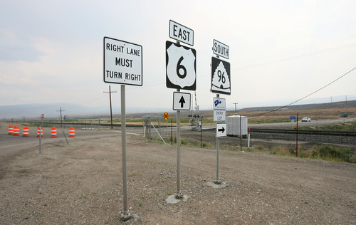 Steve Griffin | The Salt Lake Tribune   Orange barriers block the entrance to SR 96 towards Scofield, Utah Monday July 2, 2012 because of a wildfire in the area.
