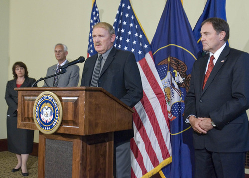 Paul Fraughton | Salt Lake Tribune State Forester Dick Buehler, with House Speaker Becky Lockhart and Senate President Mike Waddoups to his right and Gov. Gary Herbert on his left, will be working with counties in deciding where target shooting will be limited.  Monday, July 2, 2012