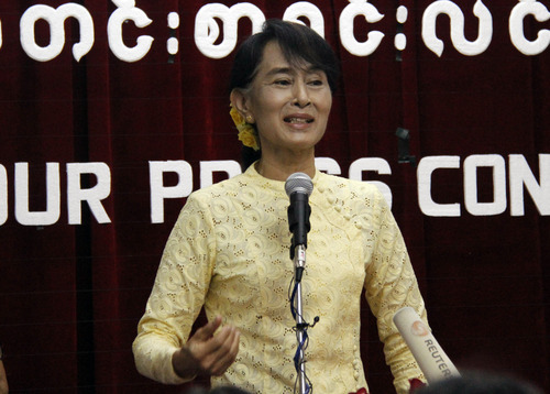 Myanmar opposition leader Aung San Suu Kyi talks to journalists during a press conference at the headquarters of her National League for Democracy party on Tuesday, July 3, 2012, in Yangon, Myanmar. (AP Photo/Khin Maung Win)