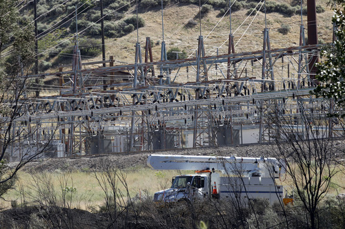Al Hartmann     The Salt Lake Tribune A brush fire burned to within 100 feet of a Rocky Mountain Power substation at the mouth of Ogden Canyon Tuesday morning July 3.