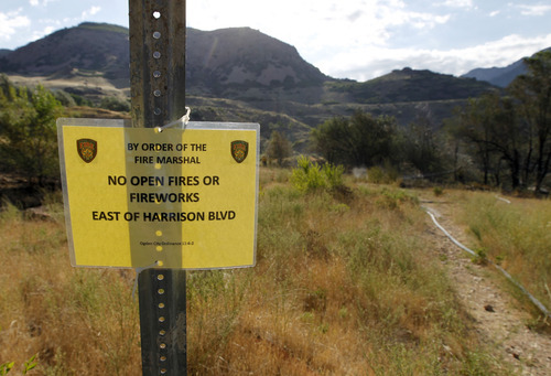 Al Hartmann     The Salt Lake Tribune Fireworks notification at the mouth of Ogden Canyon where an early morning fire occured Tuesday July 3.