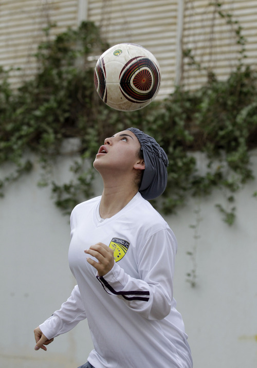 In a May 21, 2012 photo, Rana Al Khateeb, a 23-year-old member of a Saudi female soccer team practices at a secret location in Riyadh, Saudi Arabia. While Olympic leaders and human rights advocates are encouraged by signs that Saudi Arabia may bow to pressure and send female athletes to the Summer Games, women athletes in the ultraconservative kingdom are worried about a backlash at home.(AP Photo/Hassan Ammar)