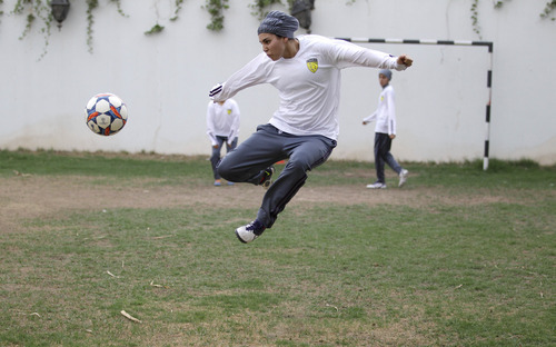 In this May 21, 2012 photo, Rana Al Khateeb, a 23-year-old member of a Saudi female soccer team,  practices at a secret location in Riyadh, Saudi Arabia. While Olympic leaders and human rights advocates are encouraged by signs that Saudi Arabia may bow to pressure and send female athletes to the Summer Games, women athletes in the ultraconservative kingdom are worried about a backlash at home.(AP Photo/Hassan Ammar)
