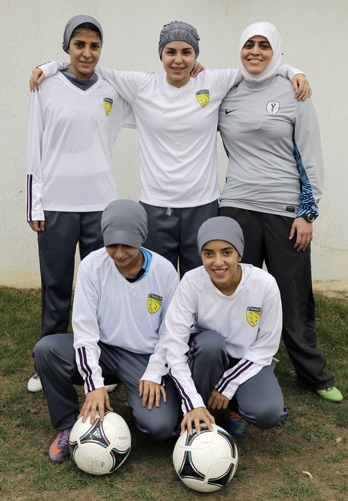 In this May 21, 2012 photo, members of a Saudi female soccer team pose before a training session in a secret location in Riyadh, Saudi Arabia.  Back row, standing from left are: Rawh Abdullah, Saudi, 28; Rana Al Khateeb, Saudi, 23; and Mawada Chaballout, American, 27. Bottom row are: Mashael Abdullah, Saudi 27; left, and Lamia Fahad, Saudi, 24. While Olympic leaders and human rights advocates are encouraged by signs that Saudi Arabia may bow to pressure and send female athletes to the Summer Games, women athletes in the ultraconservative kingdom are worried about a backlash at home. (AP Photo/Hassan Ammar)