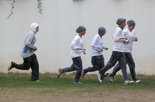 In this May 21, 2012 photo, members of a Saudi female soccer team practice at a secret location in Riyadh, Saudi Arabia. While Olympic leaders and human rights advocates are encouraged by signs that Saudi Arabia may bow to pressure and send female athletes to the Summer Games, women athletes in the ultraconservative kingdom are worried about a backlash at home. (AP Photo/Hassan Ammar)