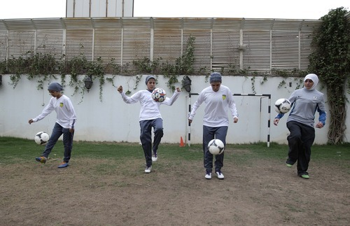 In this May 21, 2012 photo, Saudi female soccer players practice at a secret location in Riyadh, Saudi Arabia. While Olympic leaders and human rights advocates are encouraged by signs that Saudi Arabia may bow to pressure and send female athletes to the Summer Games, women athletes in the ultraconservative kingdom are worried about a backlash at home. (AP Photo/Hassan Ammar)
