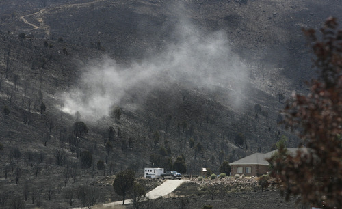 Scott Sommerdorf  |  The Salt Lake Tribune              Herriman residents who did not lose their homes said they now fear the loss of soil from winds like this on their torched hillside near Rosecrest Drive in Herriman, Sunday, July 1, 2012.