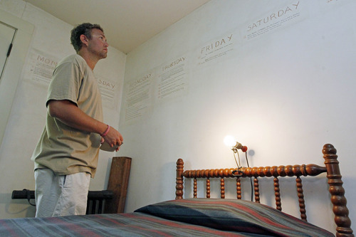 In this June 8, 2012 photograph, Ryan Spilker, a student at the University of Mississippi, studies the late Nobel Prize laureate William Faulkner's handwriting on the walls of his downstairs office at his antebellum home, Rowan Oak, now a museum owned by the University of Mississippi, in Oxford, Miss. Using pencil, Faulkner outlined events of ''A Fable,'' a 1954 novel that unfolds during Holy Week and was one of his few books not set in fictional Yoknapatawpha County. Oxford commemorates the 50th anniversary of the Nobel laureate's death July 6 with several events, including a tag-team reading of one of his novels, ''The Reivers,'' beginning about daybreak. (AP Photo/Rogelio V. Solis)
