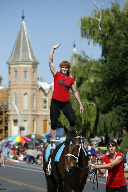 Francisco Kjolseth  |  The Salt Lake Tribune Zina Allred of the Oak Hills Vaulters waves from the top of a horse as thousands line the streets of downtown Provo to watch the Freedom Festival Parade on Wednesday, July 4, 2012.