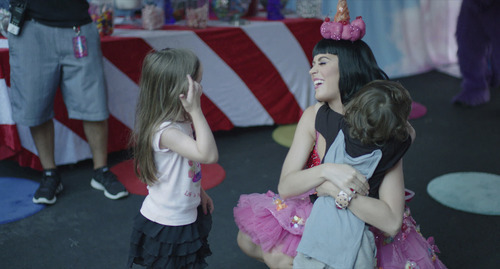 Pop star Katy Perry visits young fans backstage, in a scene from the documentary