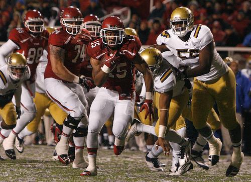 Scott Sommerdorf  |  The Salt Lake Tribune              Utah Utes running back John White IV #15 runs for a 22 yard TD during second half pay. Utah beat UCLA 31-6 at Rice-Eccles Stadium in Salt Lake City, Saturday, November 12, 2011.