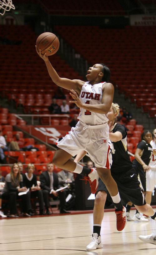 Francisco Kjolseth  |  The Salt Lake Tribune Utah's Janita Badon drives to the basket as the University of Utah women's basketball team takes on the University of Colorado on Saturday, December 31, 2011, at the Huntsman Center.
