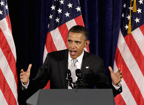President Barack Obama speaks at a fundraising event, Tuesday, June 26, 2012, in Atlanta. (AP Photo/David Goldman)