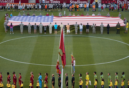 Michael Mangum  |  Special to the Tribune  The American flag is displayed during the singing of the national anthem before the MLS match featuring Real Salt Lake and Seattle Sounders at Rio Tinto Stadium in Sandy, UT on Wednesday, July 4, 2012.