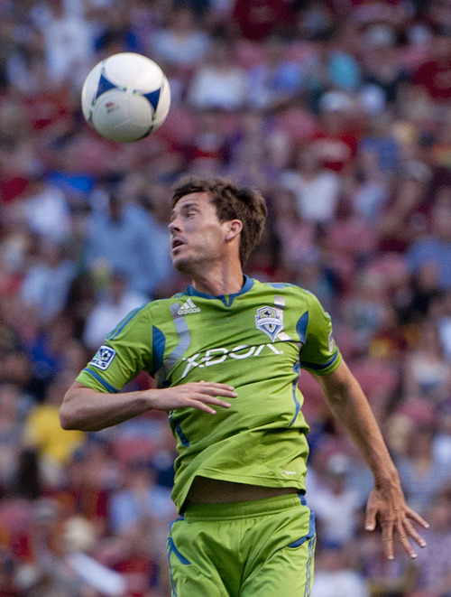Michael Mangum  |  Special to the Tribune  Seattle Sounders midfielder Brad Evans (3) heads the ball during their match against Real Salt Lake at Rio Tinto Stadium in Sandy, UT on Wednesday, July 4, 2012.