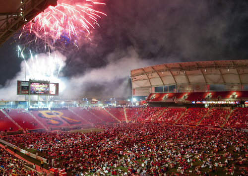 Michael Mangum  |  Special to the Tribune  Fans gather on the field to watch a fireworks display to celebrate the Fourth of July after the conclusion of the MLS match featuring Real Salt Lake and the Seattle Sounders at Rio Tinto Stadium in Sandy, UT on Wednesday, July 4, 2012. The game ended in a 0-0 draw.