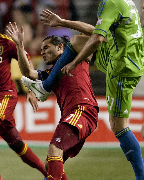 Michael Mangum  |  Special to the Tribune  Real Salt Lake forward Fabian Espindola (7) battles for possession with Seattle Sounders defender Jeff Parke (31) during their match at Rio Tinto Stadium in Sandy, UT on Wednesday, July 4, 2012. The game ended in a 0-0 draw.
