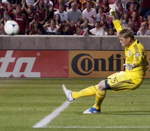Michael Mangum  |  Special to the Tribune  Seattle Sounders goalkeeper Bryan Meredith makes a late-game foot save during their match against Real Salt Lake at Rio Tinto Stadium in Sandy, UT on Wednesday, July 4, 2012. The game ended in a 0-0 draw.