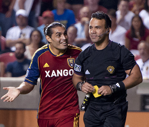 Michael Mangum  |  Special to the Tribune  Real Salt Lake forward Fabian Espindola (7) argues a yellow card he received with referee Hilario Grajeda during their match at Rio Tinto Stadium in Sandy, UT on Wednesday, July 4, 2012. The game ended in a 0-0 draw.