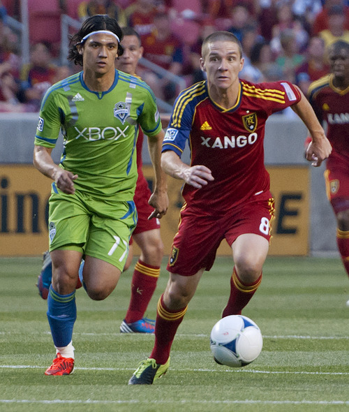 Michael Mangum  |  Special to the Tribune  Real Salt Lake midfielder Will Johnson (8) drives downfield ahead of Seattle Sounders forward Fredy Montero (17) during their match at Rio Tinto Stadium in Sandy, UT on Wednesday, July 4, 2012. The game ended in a 0-0 draw.