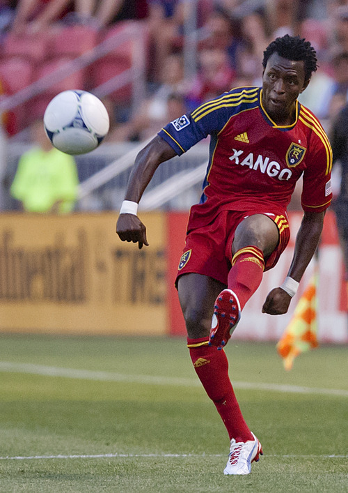 Michael Mangum  |  Special to the Tribune  Real Salt Lake defender Kenny Mansally (29) sends in a cross during their match against the Seattle Sounders at Rio Tinto Stadium in Sandy, UT on Wednesday, July 4, 2012.