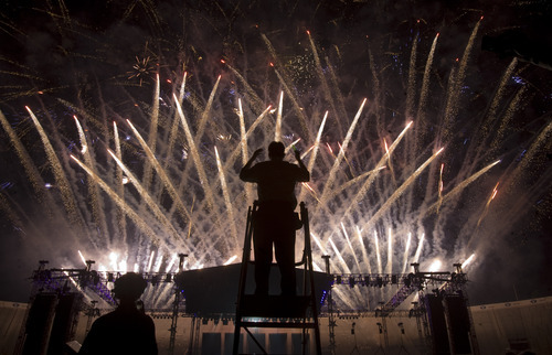 Kim Raff | The Salt Lake Tribune A conductor for the Stadium of Fire Choir directs during the Stadium of Fire fireworks display at the LaVell Edwards Stadium in Provo, Utah on July 4, 2012.