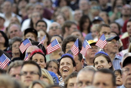 Kim Raff | The Salt Lake Tribune (from left) Anslee, Brenda, and Kaighin Callahan watch Scotty McCreery perform during the Stadium of Fire at the LaVell Edwards Stadium in Provo, Utah on July 4, 2012.