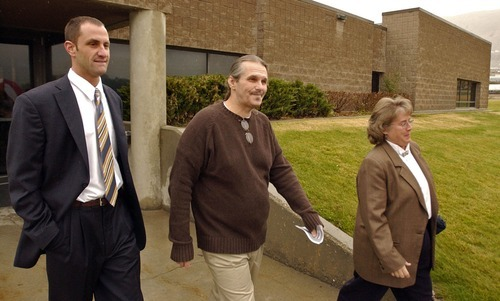 Bruce Dallas Goodman, center, is all smiles after being released from prison after serving 19 years for a rape and murder charge conviction vacated by new DNA evidence.  At his side was staff attorney Josh Bowland and Jensie Anderson, president of the Rocky Mountain Innocence Center.  Goodman who had been serving in a Gunnison prison was moved to the main prison in Draper for his release on Tuesday afternoon.     Photo by Francisco Kjolseth/The Salt Lake Tribune 11/09/2004