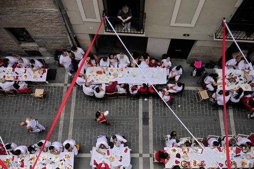 Revelers have a lunch on the street, in Pamplona, northern Spain, Friday, July 6, 2012 to celebrate the start of Spain's most famous bull-running festival with the annual launch of the