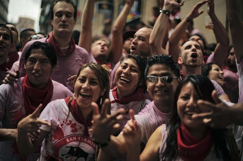 Revelers in Ayuntamiento square, in Pamplona, northern Spain, Friday, July 6, 2012 celebrate the start of Spain's most famous bull-running festival with the annual launch of the