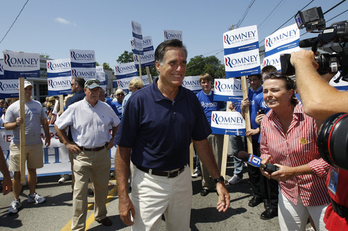 Republican presidential candidate, former Massachusetts Gov. Mitt Romney walks in the Fourth of July Parade in Wolfeboro, N.H., Wednesday, July 4, 2012. (AP Photo/Charles Dharapak)