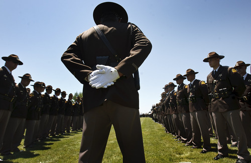 Leah Hogsten     The Salt Lake Tribune A line of hundreds of Utah Highway Patrol troopers and officers and firefighters from other Utah cities as well as troopers from New Mexico, Colorado, Texas, Arizona, Idaho and Montana honor Utah Highway Patrol Trooper Aaron Beesley as he is interred at West Point Cemetery.