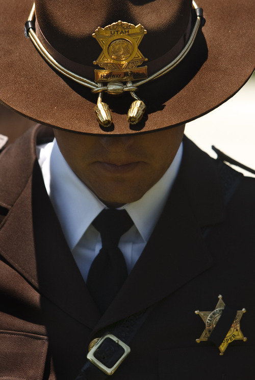 Leah Hogsten  |  The Salt Lake Tribune Utah Highway Patrol troopers wear a black sash across their badges in honor of fallen Utah Highway Patrol Trooper Aaron Beesley.Funeral services were Saturday, July 7, 2012 in Layton at Northridge High School.