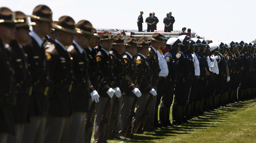 Leah Hogsten  |  The Salt Lake Tribune A line of hundreds of Utah Highway Patrol troopers and officers and firefighters from other Utah cities as well as troopers from New Mexico, Colorado, Texas, Arizona, Idaho and Montana honor Utah Highway Patrol Trooper Aaron Beesley as he is interred at West Point Cemetery.