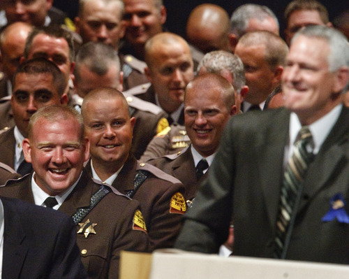Leah Hogsten     The Salt Lake Tribune Utah Highway Patrol Trooper Arik Beesley, left, laughs as Kelly Dyer talks about his brother Trooper Aaron Beesley. Dyer is Aaron Beesley's father-in-law. Funeral services for Aaron Beesley were held Saturday, July 7, 2012 in Layton at Northridge High School. Beesley is the 15th trooper and the 135th police officer to die in the line of duty, according to the UHP and the Utah Law Enforcement Memorial.