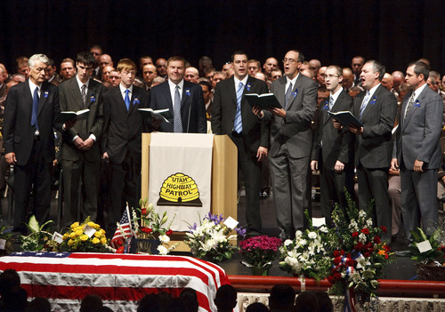 Leah Hogsten  |  The Salt Lake Tribune Uncles and cousins of Trooper Aaron Beesley sing