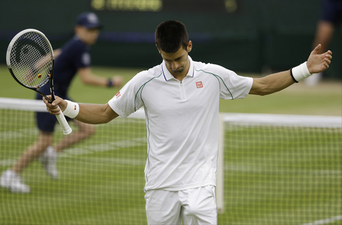 Novak Djokovic of Serbia reacts during a men's semifinals match against Roger Federer of Switzerland at the All England Lawn Tennis Championships at Wimbledon, England, Friday, July 6, 2012. (AP Photo/Kirsty Wigglesworth)