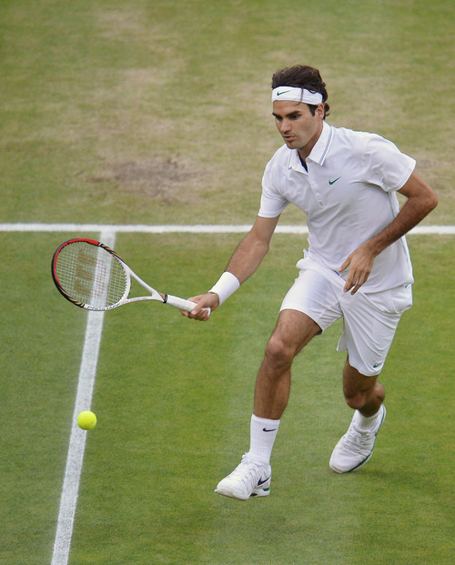 Roger Federer of Switzerland plays a shot to Novak Djokovic of Serbia during a men's semifinals match at the All England Lawn Tennis Championships at Wimbledon, England, Friday, July 6, 2012. (AP Photo/Miguel Medina, Pool)