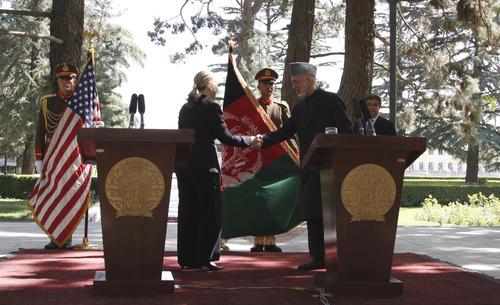 Afghan President Hamid Karzai, right, shakes hand with U.S. Secretary of State Hillary Rodham Clinton after their joint press conference at the Presidential Palace in Kabul, Afghanistan, Saturday, July. 7, 2012. Clinton announced that President Barack Obama had designated Afghanistan as a major non-NATO ally shortly after arriving in the country for talks with Karzai. (AP Photo/Ahmad Jamshid)