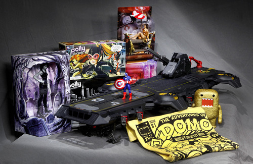In this July 5, 2012 photo, the Marvel Universe S.H.I.E.L.D. Super Helicarrier, at center with a Captain America figure on the foredeck, is seen with, from left background, a DC Comics Vertigo Death figurine, the Polly Pocket DC Comics Villain set, and a Dana as Zuul