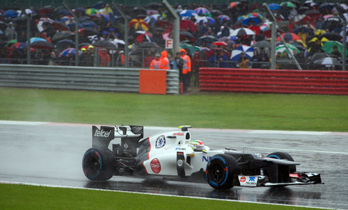 Mexico's Sergio Perez driving a Sauber-Ferrari Formula 1 car enters Club corner during qualifying at the Silverstone circuit, England, Saturday, July 7, 2012. The qualifying session will establish the starting positions for the British Grand Prix at Silverstone circuit on Sunday. (AP Photo/Tom Hevezi)