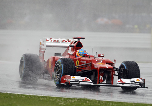 Ferrari Formula 1 car driver Fernando Alonso, of Spain,  drives his car under rain during the qualifying session at the Silverstone circuit, England, Saturday, July 7, 2012. The Formula 1 teams make preparations ahead of the British Grand Prix at Silverstone circuit on Sunday. (AP Photo/Lefteris Pitarakis)