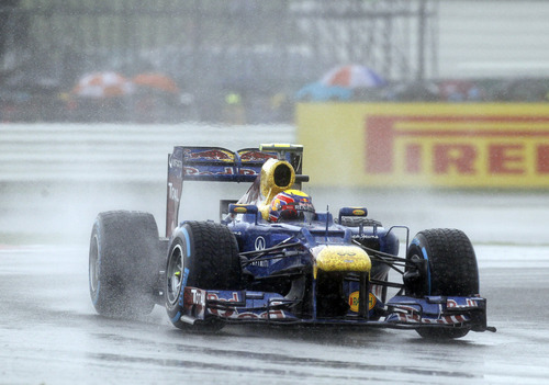 Red Bull Formula 1 car driver Sebastian Vettel, of Germany, drives his car under rain during the qualifying session at the Silverstone circuit, England, Saturday, July 7, 2012. The Formula 1 teams make preparations ahead of the British Grand Prix at Silverstone circuit on Sunday. (AP Photo/Lefteris Pitarakis)
